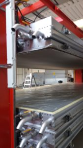 Vacuum dryer tables for processing hides